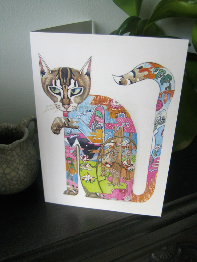 Greetings card of a cat licking it's paw